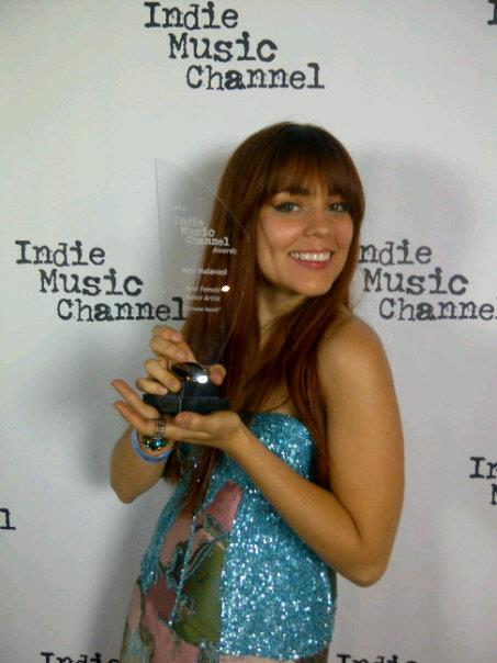 Meli with her award backstage at House of Blues